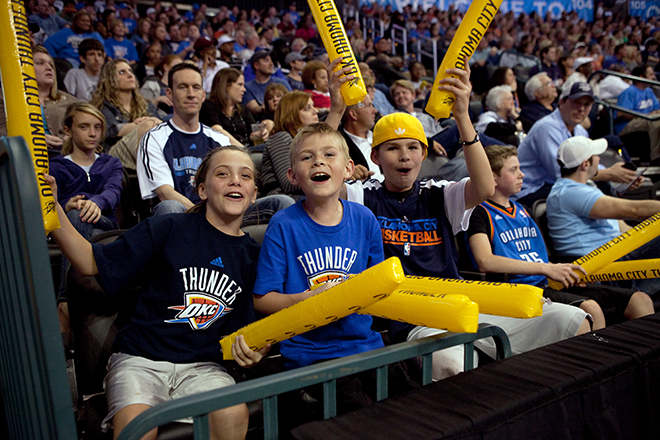 Kids cheering at the Thunder game