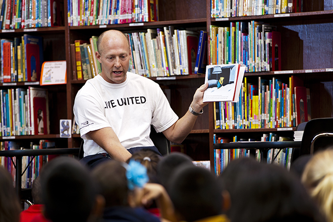 Volunteer reading to children